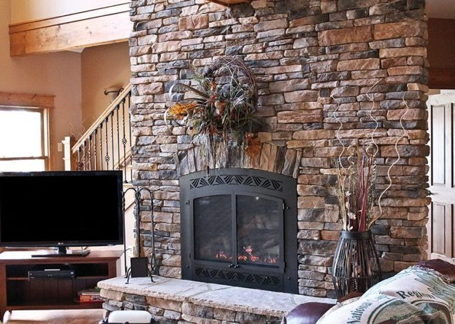 Get The Warmth of Charming Stacked Stone Fireplace Design in Your Living Room