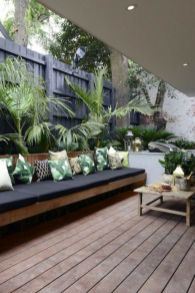 Trendy-outdoor-patio-with-black-tones-tropical-prints-and-tons-of-seating