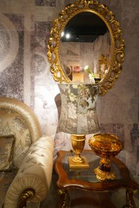 Baroque-sofa-side-table-and-round-mirror-above