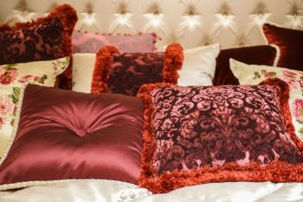 Collection-of-pillows-for-a-baroque-bedroom