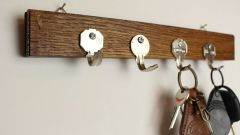 Keys-Into-A-Key-Holder-For-Wall