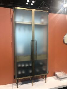 New-Format-Studio-curved-glass-cabinet