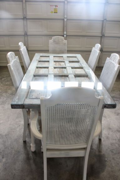 Old-door-turned-into-a-dining-table-with-glass-top