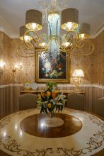 Round-baroque-dining-table-and-lighting-fixture