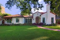 Spanish-house-exterior-with-blue-frame-windows