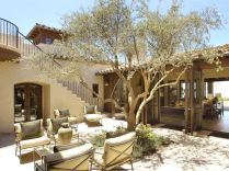 Spanish-house-with-tree-in-the-midle-of-the-courtyard
