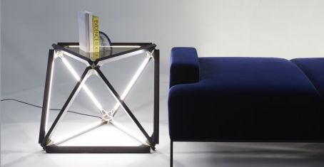Stick-light-bulb-with-a-velvet-sofa
