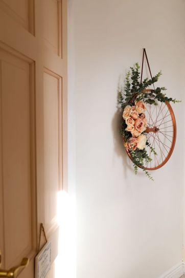 old-bike-wheel-hanging-wall