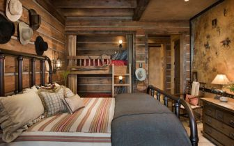 rustic-bedroom-with-normal-bed-and-bunk-beds