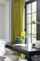 a-black-spindle-desk-paired-with-a-light-gray-velvet-chair-and-yellow-damask-curtains-for-a-very-chic-and-exquisite-home-office