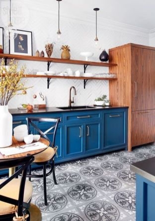 a-bold-blue-kitchen-with-a-printed-tile-floor-wooden-shelves-and-a-storage-unit-black-chairs-with-cushions-is-welcoming