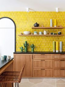 a-bold-boho-kitchen-with-rich-stained-cabinets-black-countertops-open-shelves-a-bold-yellow-tile-accent-wall