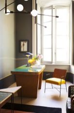 a-bold-home-office-with-a-grey-walls-yellow-edges-a-catchy-yellow-desk-with-a-green-countertop-a-yellow-chair-a-table-lamp-and-some-pendant-ones
