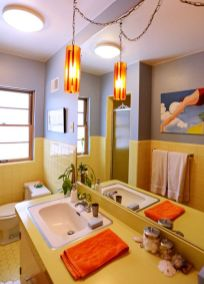 a-bright-bathroom-with-color-block-grey-and-yellow-walls-with-tiles-and-a-yellow-vanity-with-a-catchy-pendant-lamp