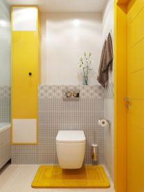 a-bright-bathroom-with-white-grey-tiles-bold-yellow-panels-a-yellow-door-and-a-yellow-rug-on-the-floor