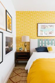 a-bright-retro-bedroom-with-yellow-wallpaper-a-bold-bed-and-bedding-a-pretty-gallery-wall-and-vintage-lamps