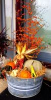 a-bucket-with-hay-corn-cobs-gourds-pumpkins-and-berries-is-a-pretty-rustic-decoration-for-fall-or-Thanksgiving