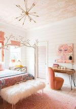 a-catchy-and-bright-feminine-bedroom-with-pink-textiles-and-bedding-a-faux-fur-bench-a-bright-artwork-and-touches-of-bold-is-very-chic