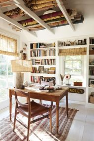 a-catchy-farmhouse-home-office-with-built-in-storage-units-and-shelves-a-wooden-desk-and-chair-a-rustic-lamp-and-woven-shades