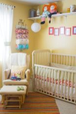 a-cheery-yellow-nursery-with-vintage-furniture-a-shelf-with-toys-colorful-textiles-and-bedding-and-a-comfy-chair-with-a-footrest