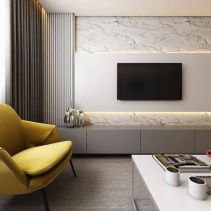 a-chic-beige-sleek-TV-unit-attached-to-the-wall-is-a-stylish-solution-for-a-modern-or-minimalist-space