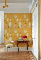 a-chic-nook-done-with-whimsical-yellow-wallpaper-a-refined-coffee-table-and-a-chair-decorative-plates-and-bold-blooms