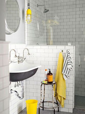 a-chic-vintage-bathroom-with-white-subway-tiles-a-grey-sink-a-vintage-stool-bright-yellow-accents-here-and-there