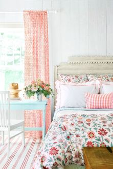 a-colorful-vintage-bedroom-with-elegant-vintage-furniture-floral-bedding-printed-curtains-a-blue-table-and-bold-blooms