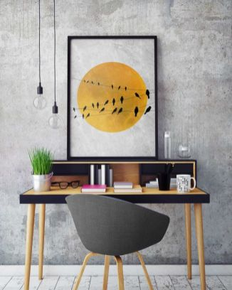 a-contemporary-home-office-with-grey-concrete-walls-a-pretty-black-and-yellow-desk-a-grey-chair-pendant-lamps-and-a-bold-print