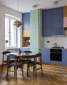 a-contemporary-kitchen-with-bold-purple-sleek-cabinets-bright-pink-and-yellow-touches-and-purple-chairs-plus-a-gold-pendant-lamp