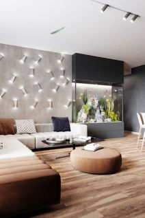 a-contemporary-living-room-finished-with-a-large-aquarium-with-lights-and-sleek-panels-is-a-very-chic-space
