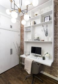 a-contemporary-white-wall-storage-unit-with-open-shelves-and-a-desk-at-its-end-is-a-fresh-idea-of-a-small-working-space