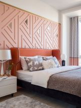 a-cool-modern-feminine-bedroom-with-apink-geometric-wall-a-terracotta-bed-white-nightstands-color-block-curtains-and-printed-bedding