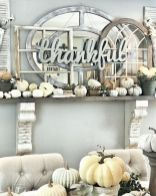 a-faux-Thanksgiving-mantel-with-small-neutral-pumpkins-lots-of-window-frames-and-a-mirror-plus-a-sign-of-metal