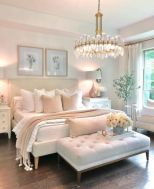 a-glam-and-feminine-bedroom-with-neutral-furniture-a-statement-crystal-chandelier-botanical-artworks-and-real-blooms