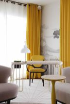 a-jaw-dropping-refined-home-office-with-a-whimsy-desk-a-couple-of-blush-chairs-a-lemon-yellow-chair-and-curtains-plus-a-grey-and-white-artwork-on-the-wall