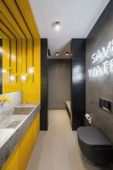 a-minimalist-bathroom-with-grey-concrete-walls-a-bright-yellow-vanity-zone-and-a-concrete-sink-neon-and-usual-lights