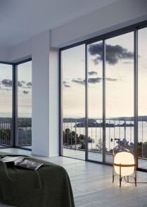 a-minimalist-bedroom-with-a-bed-some-lamps-and-gorgeous-sea-views-through-glass-walls-is-a-fantastic-space-to-be