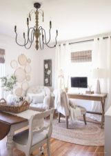 a-neutral-and-cozy-farmhouse-home-office-with-a-wooden-desk-and-a-table-neutral-upholstered-chairs-a-vintage-chandelier-macrame-art-on-the-wall
