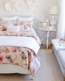 a-refined-Parisian-style-bedroom-with-chic-furniture-floral-bedding-and-a-floral-applique-on-the-wall-plus-some-blooms