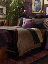 a-refined-and-moody-bedroom-with-purple-walls-heavy-dark-furniture-and-a-gallery-wall-in-gold-frames