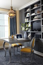 a-refined-home-office-with-yellow-walls-a-large-built-in-grey-storage-unit-a-grey-desk-and-grey-and-yellow-chairs-grey-curtains-and-a-chic-pendant-lamp