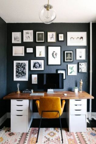 a-refined-mid-century-modern-home-office-with-a-graphite-grey-wall-with-a-black-and-white-gallery-wall-a-desk-a-yellow-leather-chair