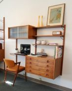 a-rich-stained-mid-century-modern-storage-unit-with-open-shelves-and-drawers-and-a-small-desk-part-is-very-functional