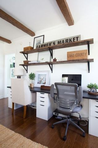 a-simple-farmhouse-home-office-with-industrial-shelves-a-shared-desk-modern-chairs-and-some-potted-greenery