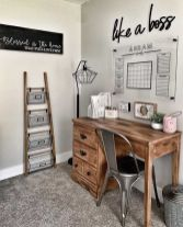 a-small-and-cozy-farmhouse-home-office-with-a-wooden-desk-a-metal-chair-a-ladder-and-wire-basket-storage-unit-and-an-acrylic-board