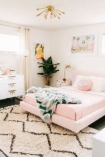 a-tropical-girlish-bedroom-with-a-pink-floating-bed-a-printed-rug-and-bedding-bold-artworks-and-touches-of-gold