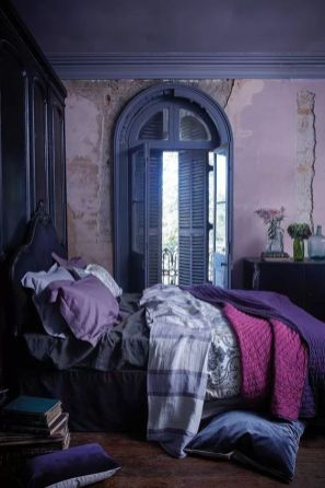a-unique-bedroom-with-lavender-walls-a-deep-purple-bed-and-blue-shutters-purple-and-pink-bedding