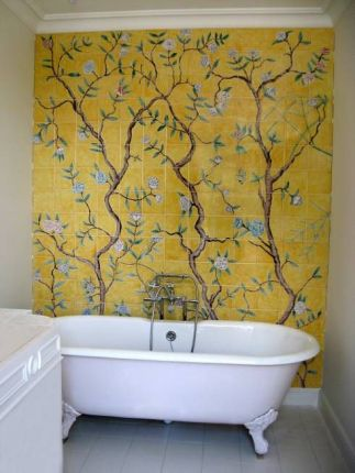 a-vintage-bathroom-with-a-yellow-wall-tile-mosaic-with-trees-and-blooms-a-lilac-clawfoot-tub-and-white-furniture