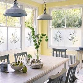 a-vintage-dining-space-with-yellow-walls-a-white-table-some-grey-chairs-and-pendant-lamps-a-wooden-console-table